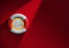 Rettungsring mit Euromünze Lizenzfreie Stockbilder