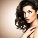 Retty fashion model with dark brown eye makeup Stock Image