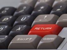 Return. Red return/enter-key on computer keyboard Stock Image