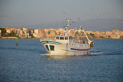 The return of a fishing boat in the port of Anzio Royalty Free Stock Photo
