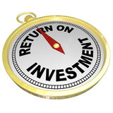 Return on Investment Compass Pointing to ROI Money Choices. A gold compass with red needle pointing to words Return on Investment to illustrate ROI, investing in Stock Photo
