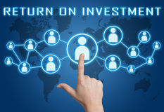 Return on Investment. Concept with hand pressing social icons on blue world map background Royalty Free Stock Photos