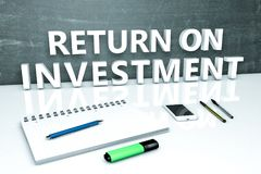 Return on Investment. Text concept with chalkboard, notebook, pens and mobile phone. 3D render illustration Royalty Free Stock Photo