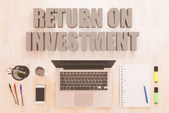 Return on Investment. Text concept with notebook computer, smartphone, notebook and pens on wooden desktop. 3D render illustration Royalty Free Stock Photography