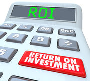 Return on Investment ROI Calculator Button Words. ROI and Return on Investment Words on a calculator display and its buttons to figure the costs and profits in Royalty Free Stock Photos