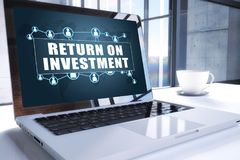 Return on Investment. Text on modern laptop screen in office environment. 3D render illustration business text concept Stock Photo