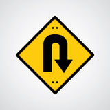 Return symbol yellow road sign Stock Photo