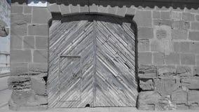 Return to hard life. Door wood wall stone antiguo handmade Stock Photos