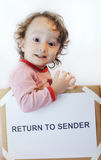 Return to sender. Child in box with return to sender note Stock Images