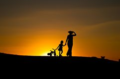 Return from walk. Silhouettes. royalty free stock photography