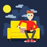 Returnera på soffan som håller ögonen på en film Arkivbild