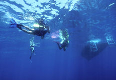 Returning Home. Divers returning to the boat after an enjoyable adventure Stock Photography