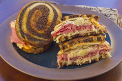 Reuben Chips Pickle. Famous New York Reuben corned beef sandwich with chips and a pickle Stock Photos