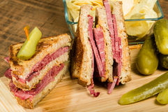 Reuben sandwich with dill pickles Stock Photo
