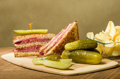 Reuben sandwich with dill pickles Royalty Free Stock Photo