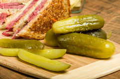 Reuben sandwich with dill pickles Stock Image