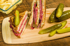 Reuben sandwich with dill pickles Royalty Free Stock Images