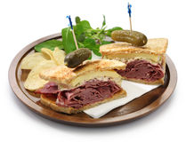 Reuben sandwich, pastrami sandwich. Reuben sandwich with pastrami and swiss cheese isolated on white background Stock Images
