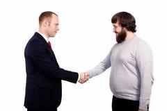 Reunião da parceria do negócio Aperto de mão dos businessmans da imagem Aperto de mão bem sucedido dos homens de negócios após o  Fotografia de Stock Royalty Free