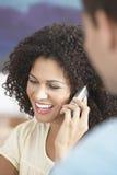 Reunião de Using Cellphone In da mulher de negócios fotografia de stock