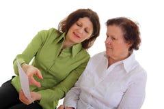 Reunião sênior da mulher com agente Imagem de Stock