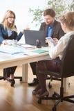 Reunión de negocios en curso Fotos de archivo