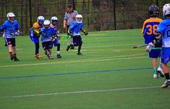 Reuniões da lacrosse do menino Fotos de Stock Royalty Free