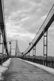 Reunification bridge,guiding light,trek. Kiev, winter is coming.Light directs the eye but the road ahead stock photo
