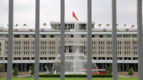 Reunification palace in Ho Chi Minh. Reunification Palace built on the site of the former Norodom Palace, is a landmark in Ho Chi Minh City, Vietnam. It was stock video