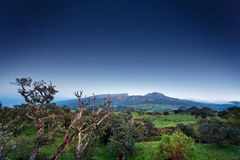 Reunion Island landscape. Scenic countryside landscape with mountains and blue sky background, Reunion Island National Park stock photography