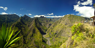 Reunion Island Park & Mountain. View of the mountains of Reunion Island National Park with the road below and clouds and sky above royalty free stock images