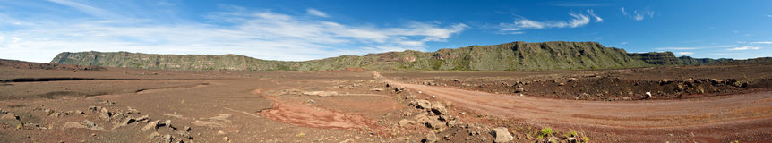 Reunion National Park. Panoramic scenic view of road on volcanic landscape of the Plaine des Sables, Reunion Island Royalty Free Stock Photo