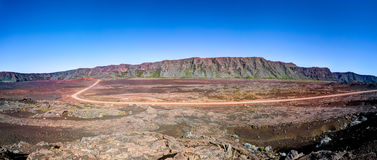 Reunion National Park. Panoramic scenic view of road on volcanic landscape of the Plaine des Sables, Reunion Island Stock Images