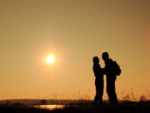 Reunion. Silhouette of men and women happy to meet  each other after time Stock Image