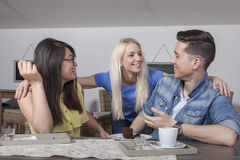 Reunion of three young adults royalty free stock photography