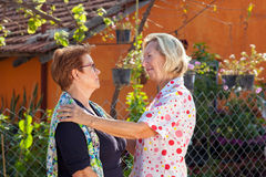 Reunion between two elderly ladies Royalty Free Stock Photography