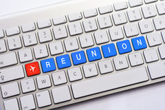 REUNION writing on white keyboard with a aircraft sketch Royalty Free Stock Photos