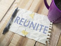 Reunite, Motivational Words Quotes Concept. Reunite, business life motivational inspirational quotes, words typography top view lettering concept royalty free stock photography