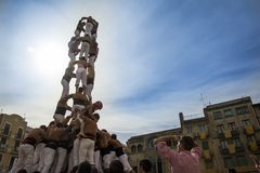 REUS, SPAIN - OCTOBER 25, 2014: Castells Performance, a castell is a human tower built traditionally in festivals within Catalonia. This is also inscribed on stock photography
