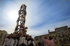 REUS SPANIEN - OKTOBER 25, 2014: Den Castells kapaciteten, en castell är ett mänskligt torn som traditionellt byggs i festivaler  arkivbild
