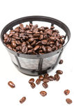 Reusable coffee filter filled with beans Royalty Free Stock Images
