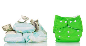 Reusable diaper saves money. Reusable and disposable diapers, dollars isolated on white background Stock Photos