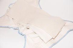 Reusable diapers from natural cotton fabric on a white background,. Natural swaddling Stock Photo