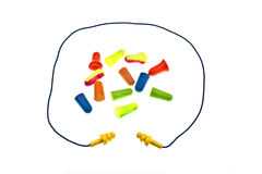 Reusable Ear Plugs With Cord. Surrounding a variety of colorful disposable ear plugs Royalty Free Stock Image