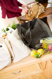 Reusable: Focus on Full Bags of Groceries. Series with a woman unpacking groceries and using reusable fabric bags stock photography