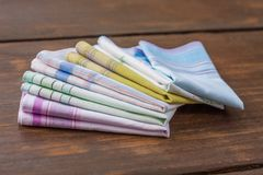 Reusable 100 percent cotton handkerchiefs. Using reusable textile, pure cotton colourful handkerchiefs for blowing nose instead of single use paper tissues Royalty Free Stock Photography