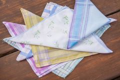 Reusable 100 percent cotton handkerchiefs. Using reusable textile, pure cotton colourful handkerchiefs for blowing nose instead of single use paper tissues Royalty Free Stock Image