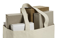 Reusable shopping bag. Cloth shopping bag with various cardboard boxes. ProPhotoRGB color space, clipping path included Stock Photos