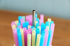 Reusable stainless steel straw. With disposable straws royalty free stock images