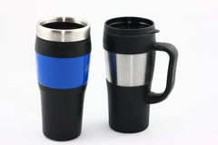 Reusable Travel Mugs. Two reusable travel mugs photographed on a white background Stock Photo